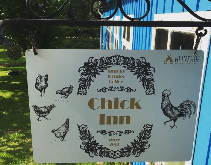 "Check in area sign with name ""chick inn"""